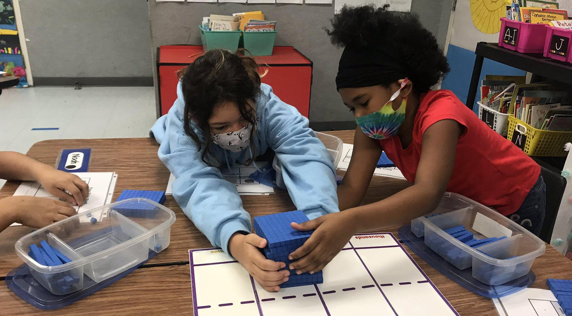 Glyndale Elementary students using plastic block manipulatives to learn place value.