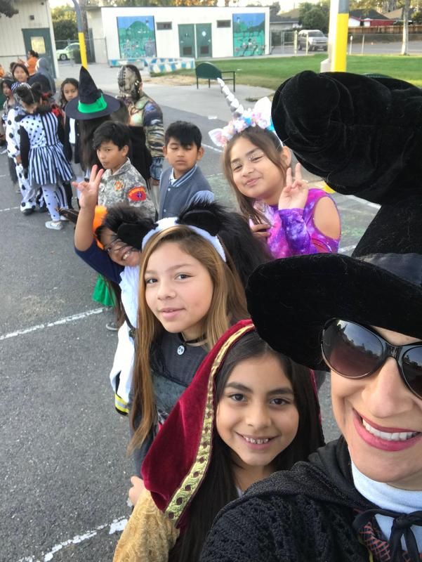 a teacher with her class in costume