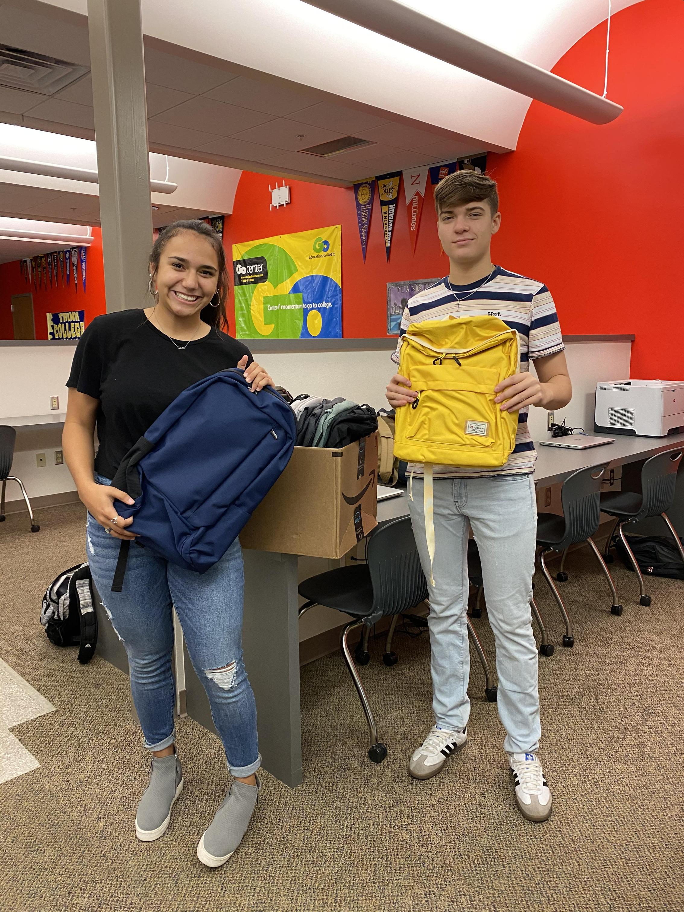 Interact donation of backpacks