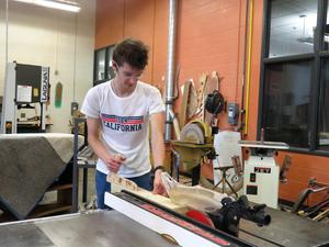 High school students cut the wood to size.