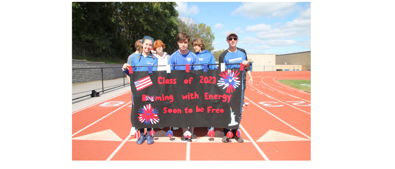 students carrying a banner