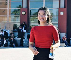Gabrielino Speech student holding a trophy