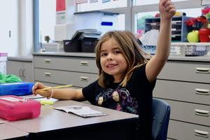 Dual Immersion Student Raising her hand