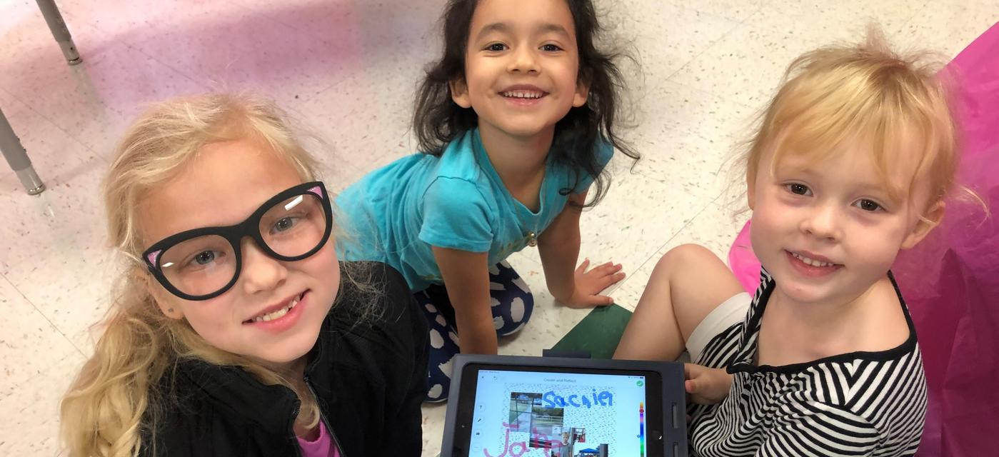 young students learning to write with the use of technology