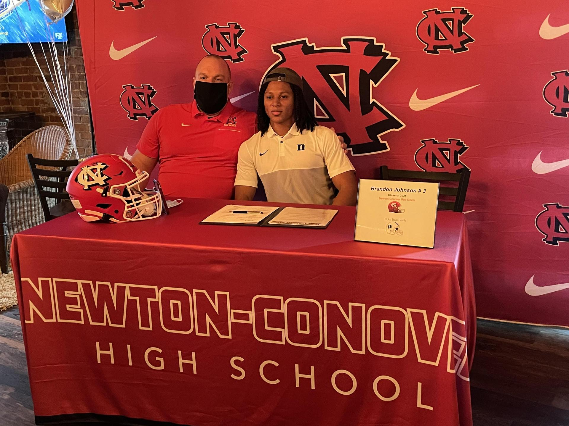 Brandon J and Coach Pack on signing day.