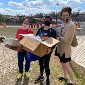 SES Teachers and boxes of supplies