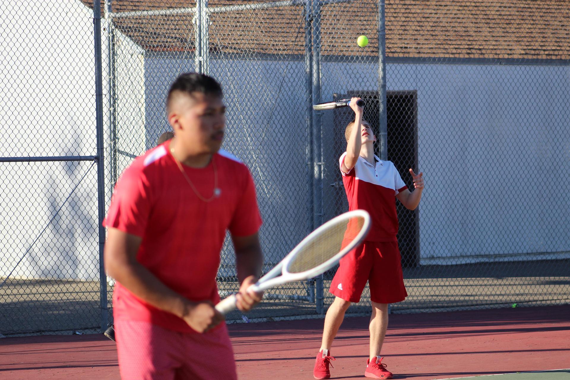 Boys playing tennis against Yosemite