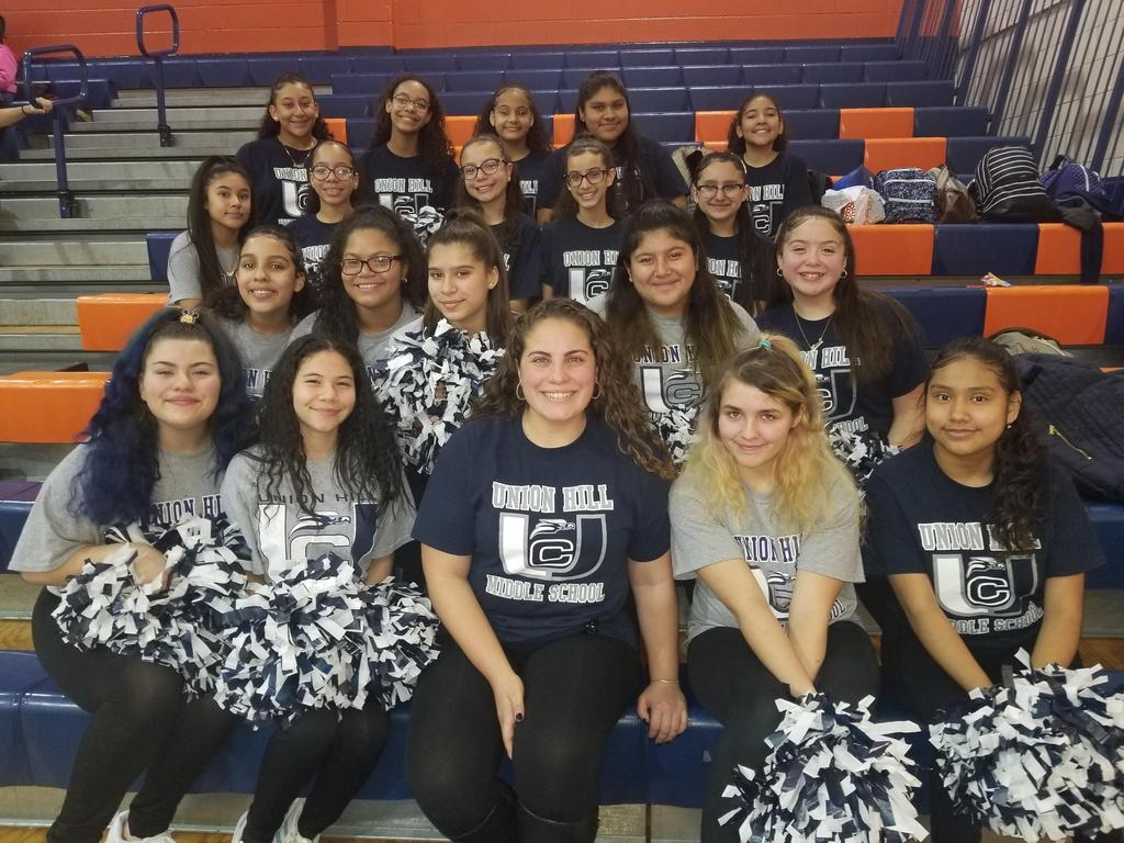 UHMS Cheerleaders with coach on bleachers