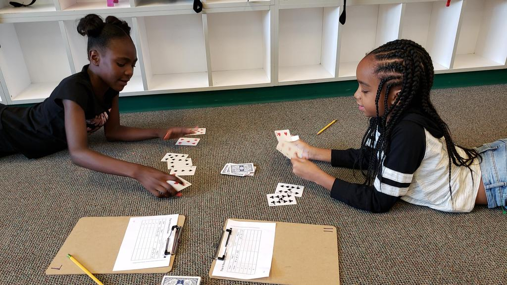2 students playing math card game