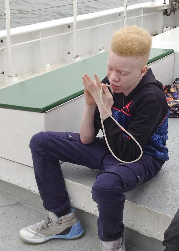 Student learning to make a knot used in sailing.
