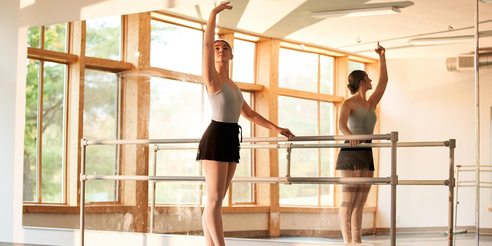 A student practicing in Creative Edge Dance Studio.