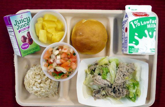HIDOE School Lunch Photo fruit, kale pig with cabbage, rice, loom tomato, milk and juice.