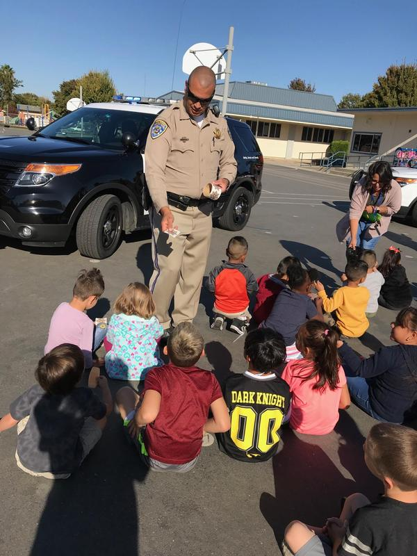 officer presenting to young students