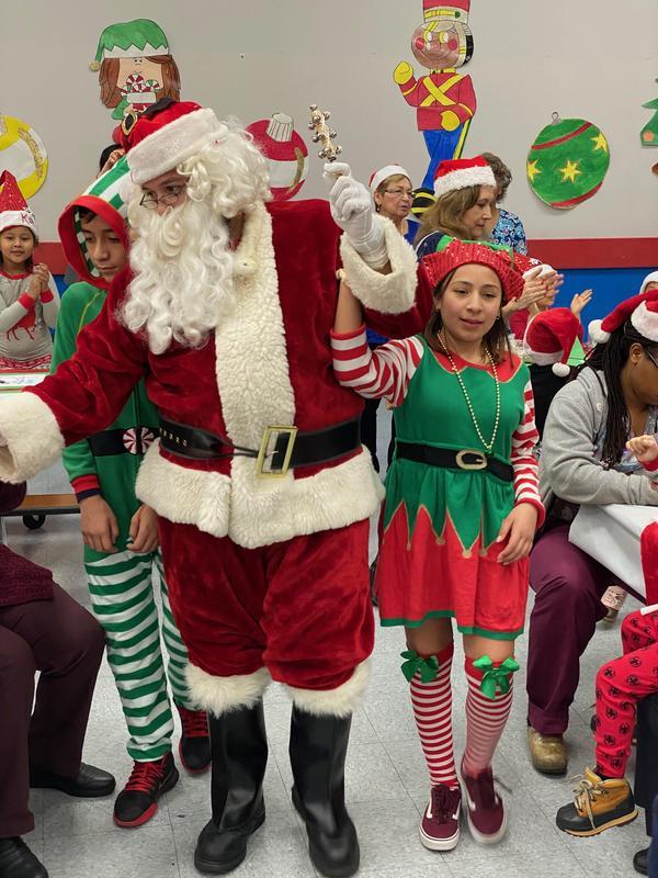 Santa holding onto a female elf
