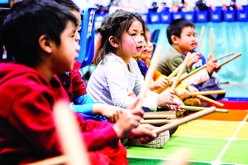 Roosevelt Elementary students play with musical instruments.