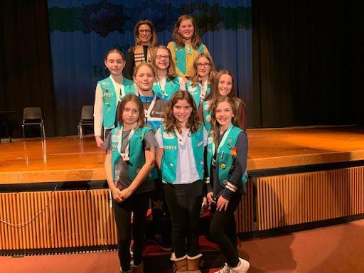 Dr. Genco poses for a picture with Girl Scout honorees.