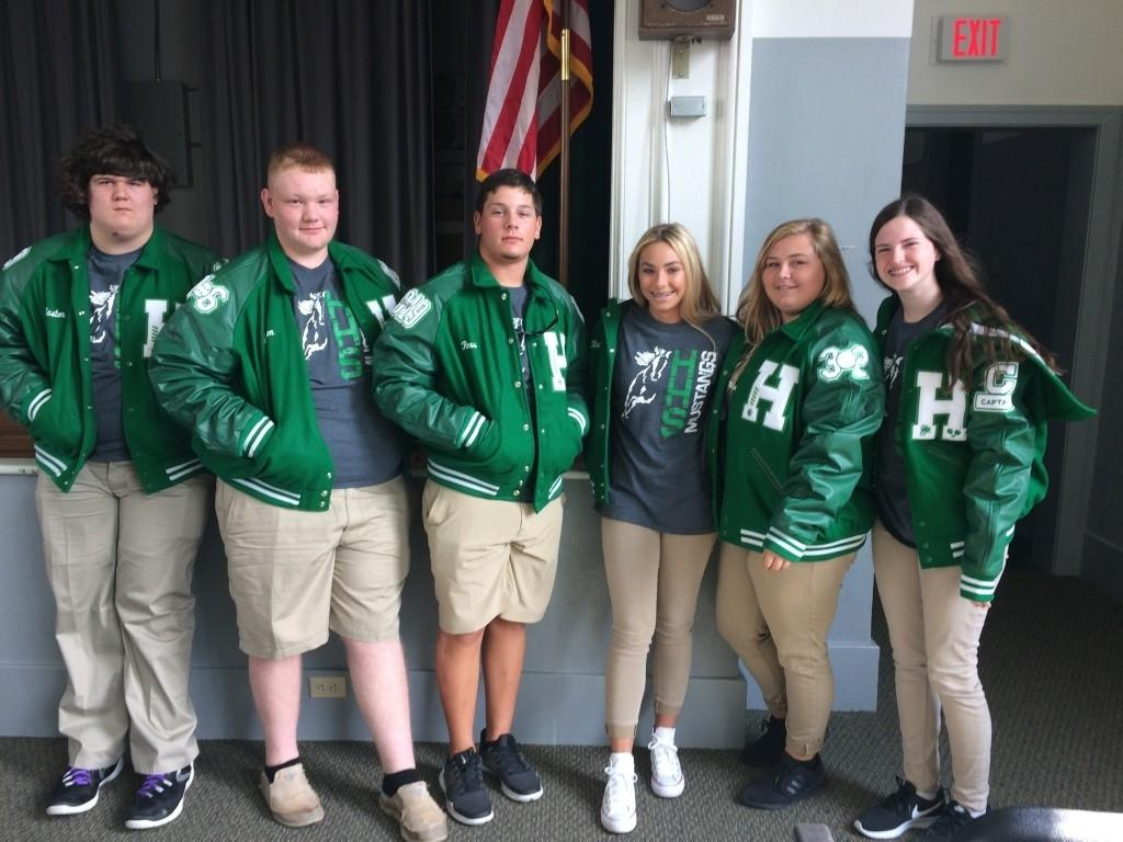 students in letterman jackets