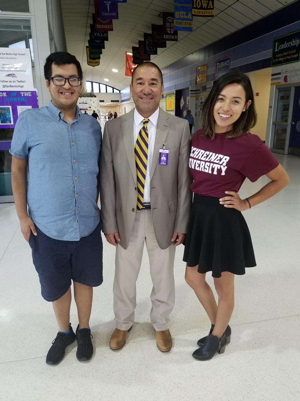 Mr. Sanchez, Principal, posing with students.