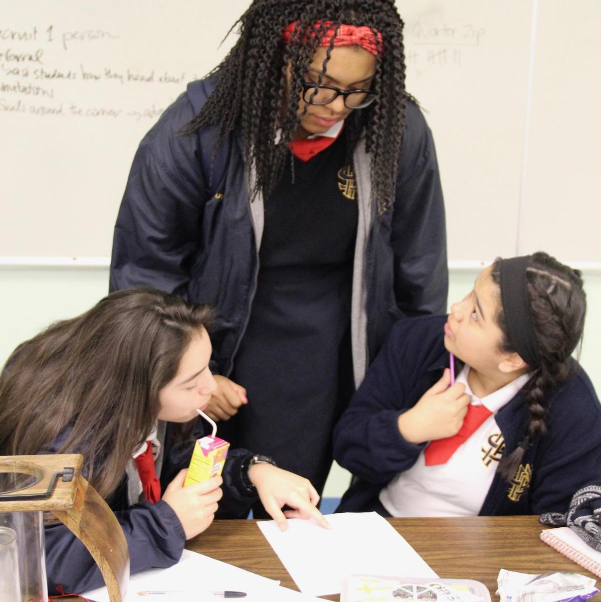 three students tutoring