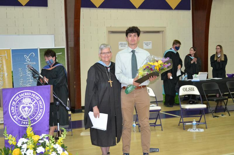 photo of OLSH student receiving Blessed Angela Award