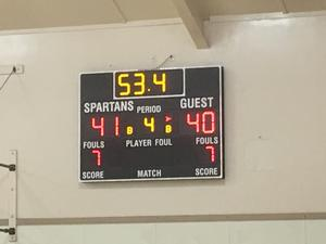 basketball scoreboard with scores for home and guest teams