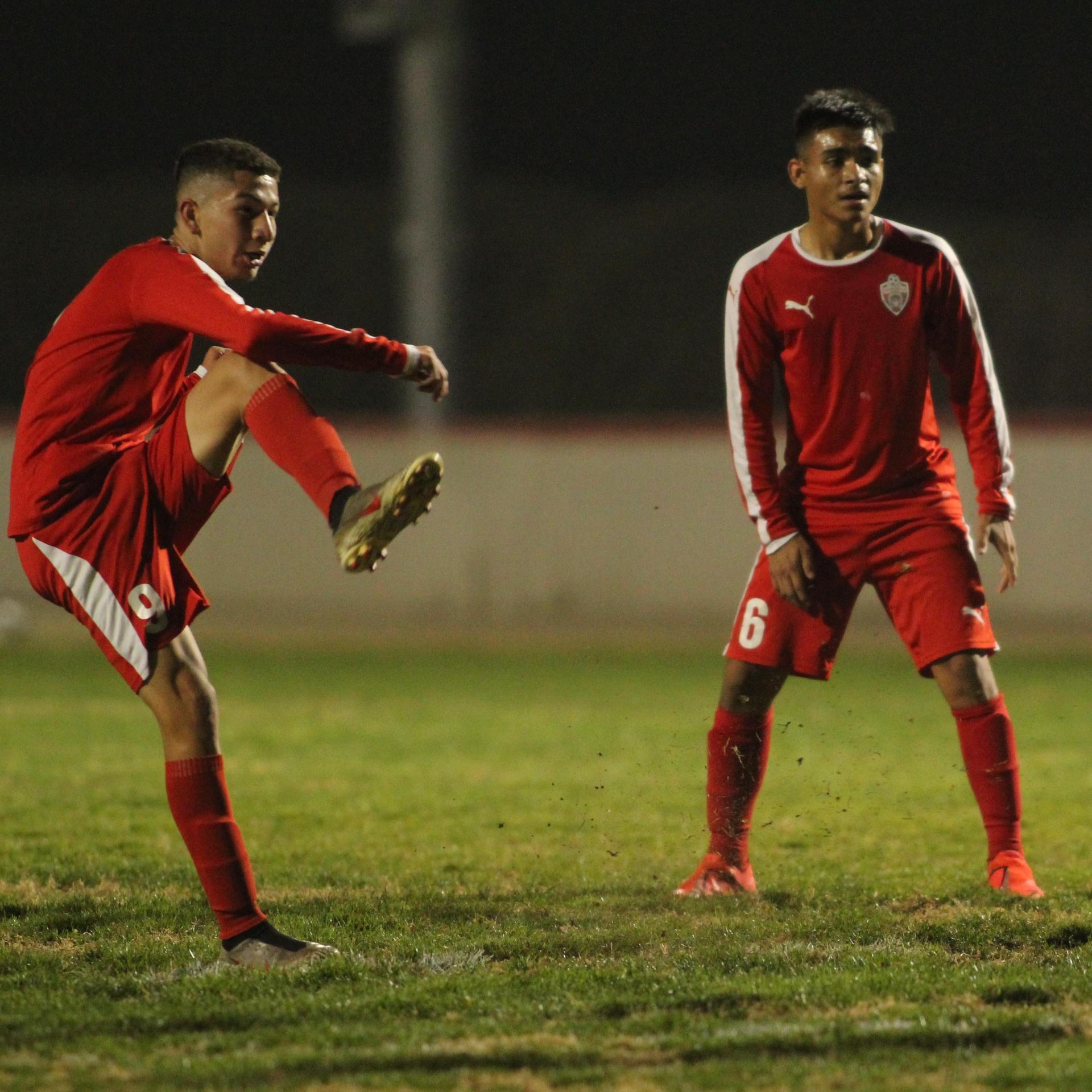 Jose Renteria and Arwin Brizo with the ball