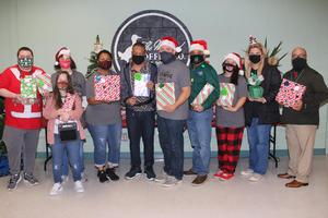 EWCC adult transition students deliver Christmas gifts to students at TISD campuses.