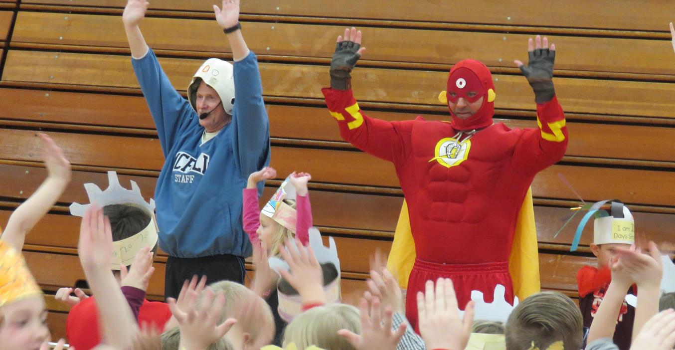 Students celebrate 100th Day of school with Zero the Hero and Mr. Greenman.