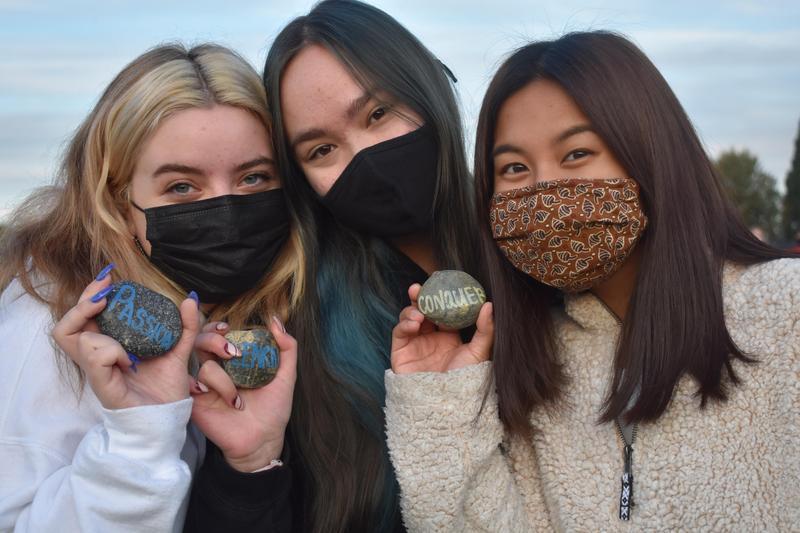 three girls holding rocks