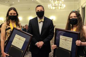 Valedictorians Kelly Blatter and Ciara Anderson receive their award from Dr. Hambleton at the Top Ten Event.