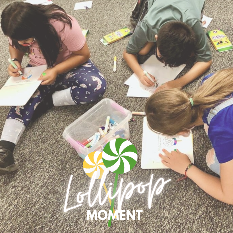 photo of kids using markers to write on notecards and text that says lollipop moment