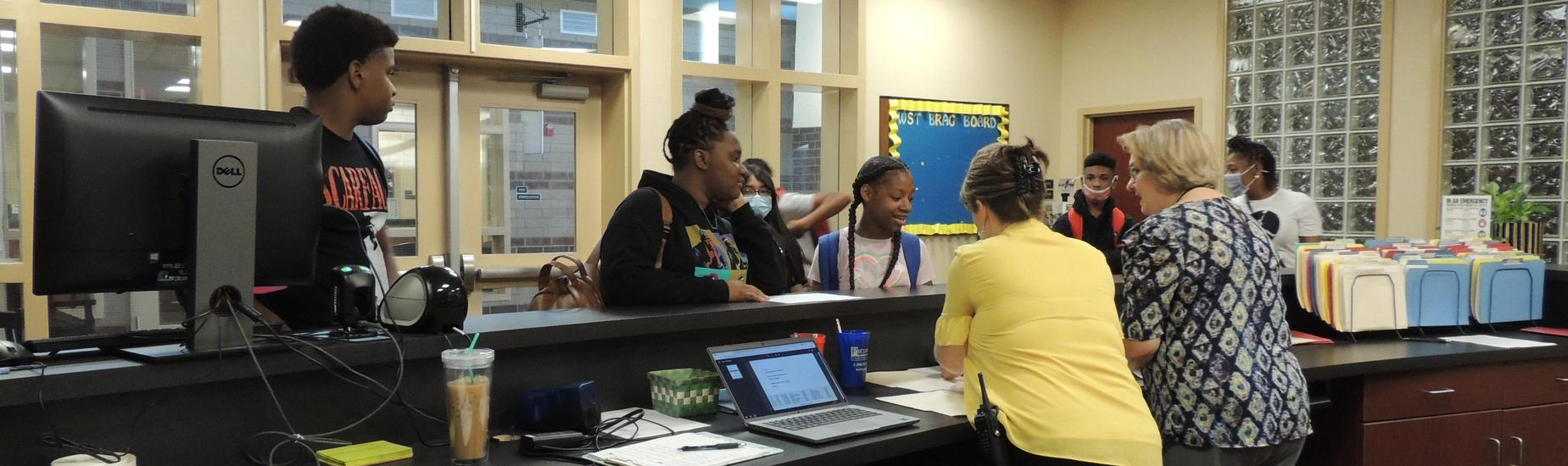 Mrs. Watts and Mrs. Moore helping students in the Guidance office
