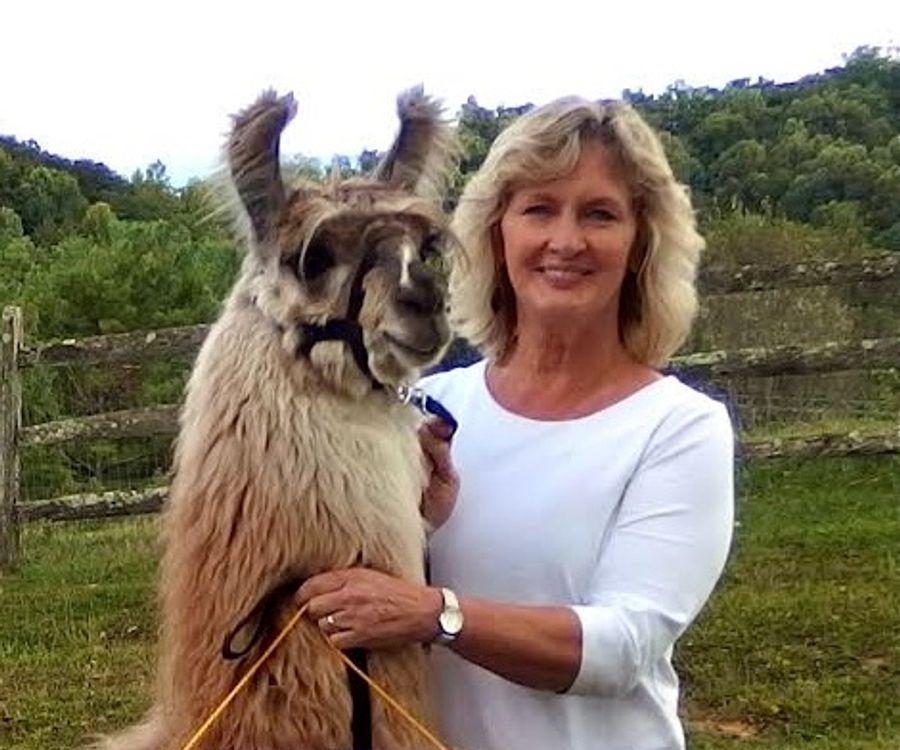 Carolyn and Corelli the llama on the farm.