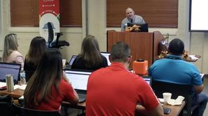 Miguel Guhlin, a Microsoft certified master trainer with the Texas Computer Education Association, demonstrates Microsoft Office 365 apps to administrators during the Edinburg CISD Fall Technology Academy in Edinburg.