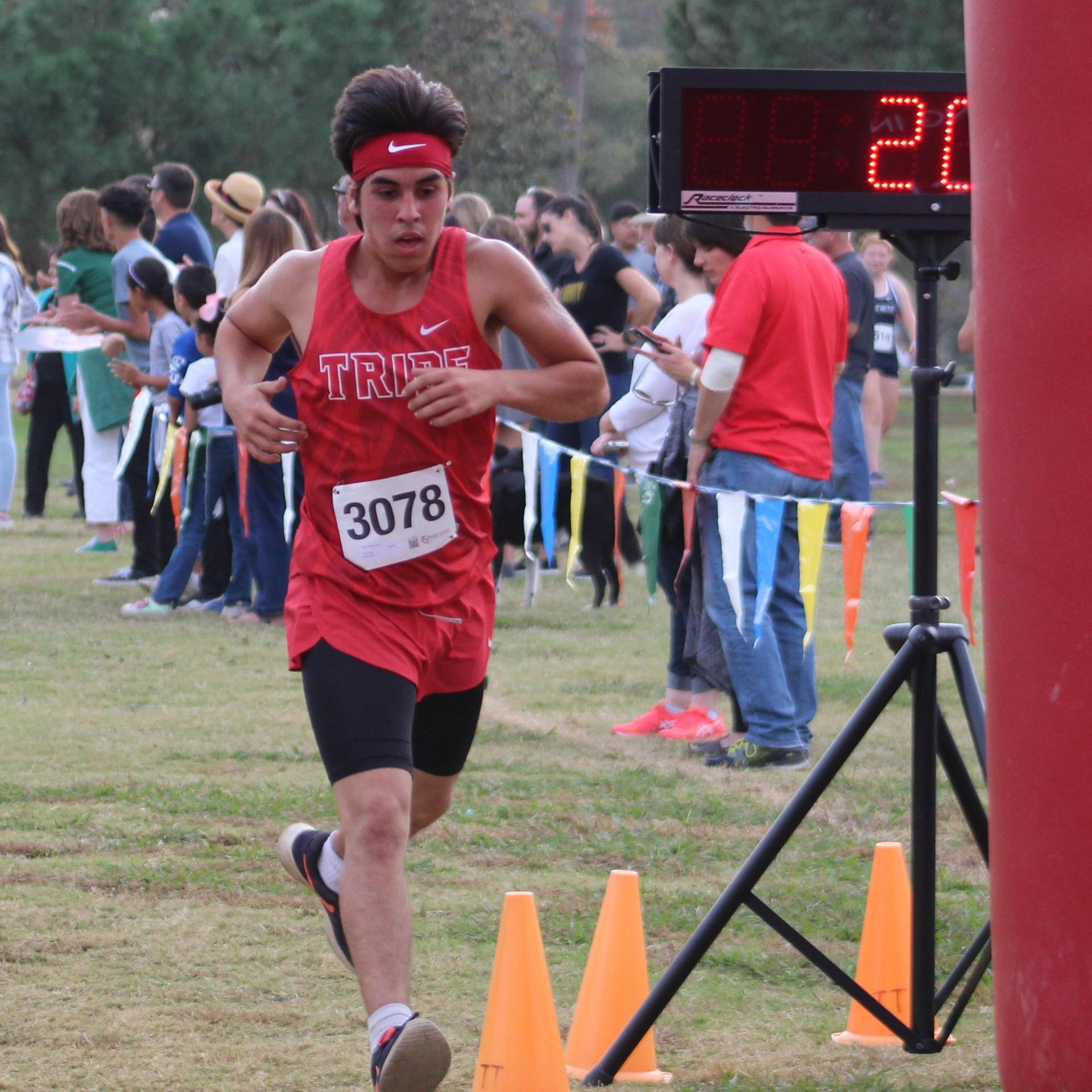 Raymond Mendoza crossing finish line