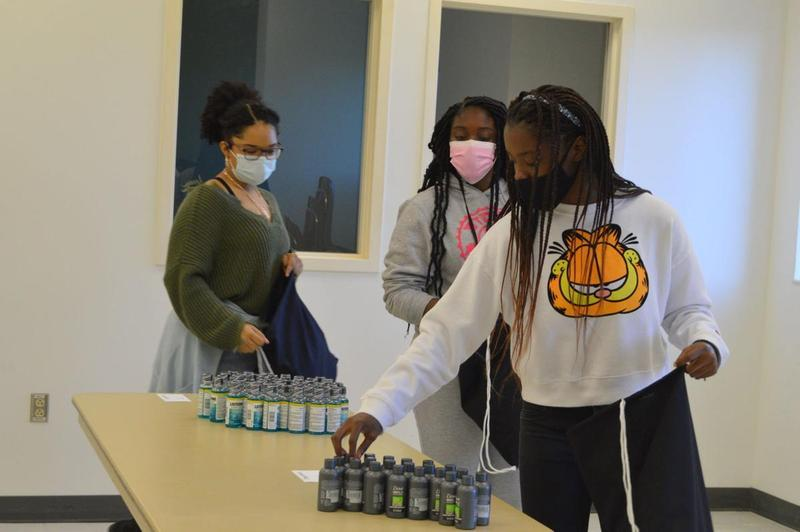 Golden Isles College & Career Academy students pack bags with hygiene products for local homeless veterans.