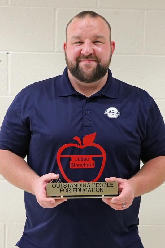 Jesse Blanchard with award