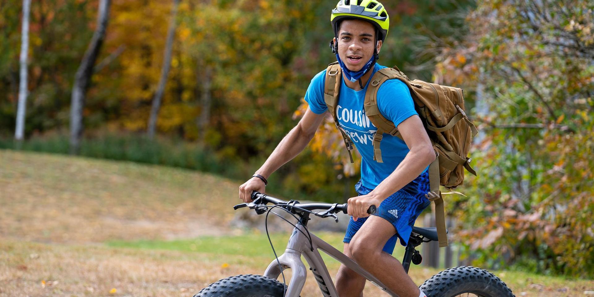 A student mountain biking.