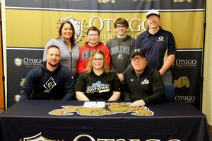 Kayla with her family and coaches