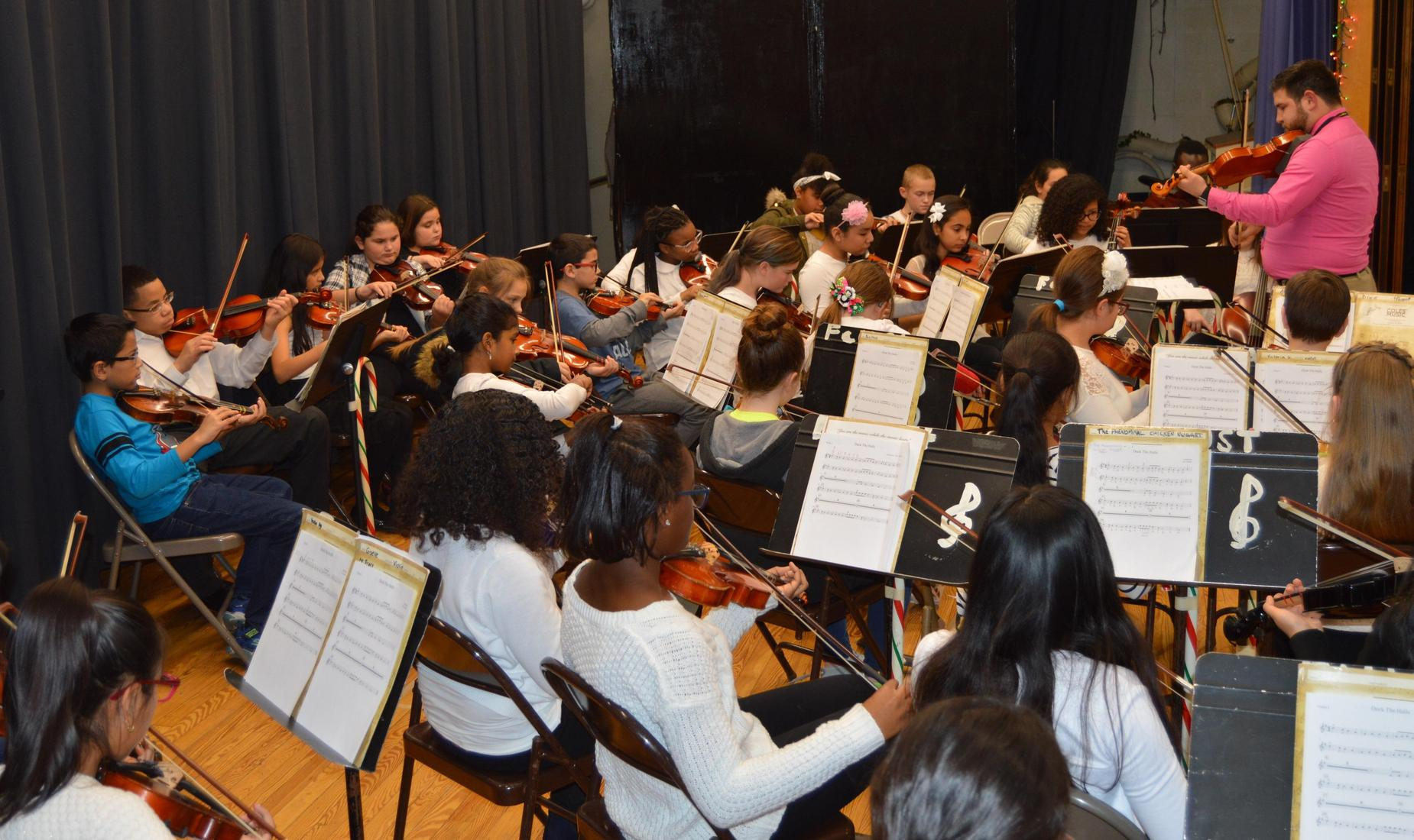Boys and girls in the orchestra at Faust Elementary perform their winter concert