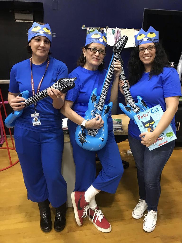 three teachers dressed as pete the cat
