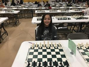 student with chess board