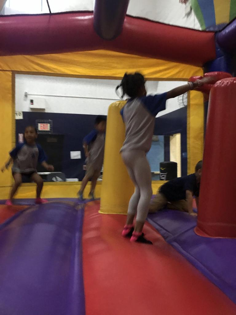 kids jumping in a bouncy house