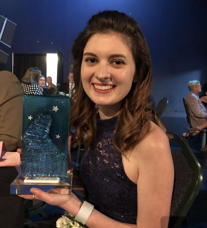 Bridgitt Cornish holding her award.