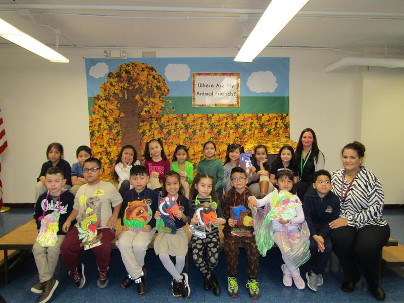 students dressed in animal costumes for the animal play