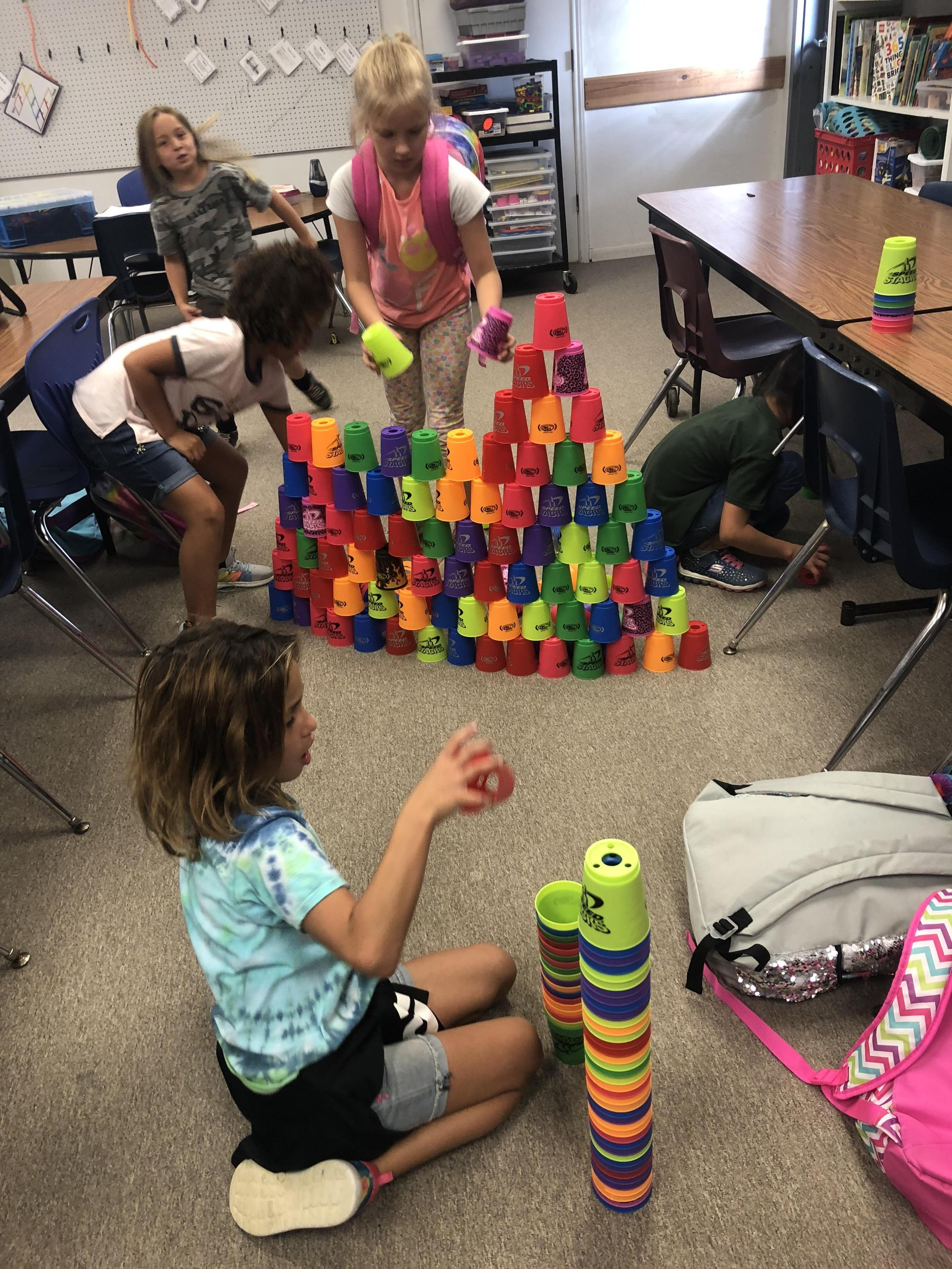 Students building things with cups.