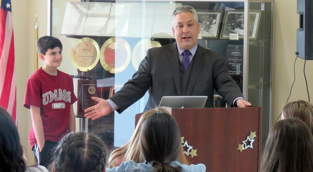 EHS principal speaks at a podium