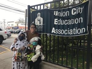 Cruella de Vil and a dalmatian outside school