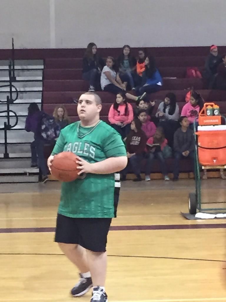 Student shooting a basket