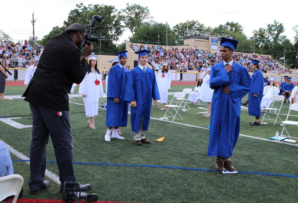 Photo of graduates posing for pictures